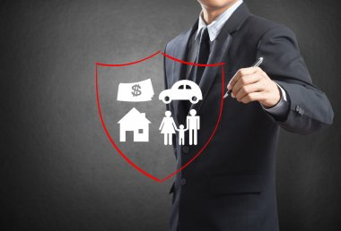 Business man drawing shield protecting family, house, car, money.