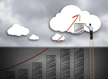 Businessman climbing ladder drawing growth chart on cloud