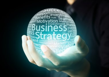 Businessman hand showing business strategy word