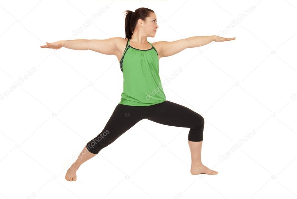 Woman Doing Yoga Pose Called Warrior 2 Arms Out Stock Photo