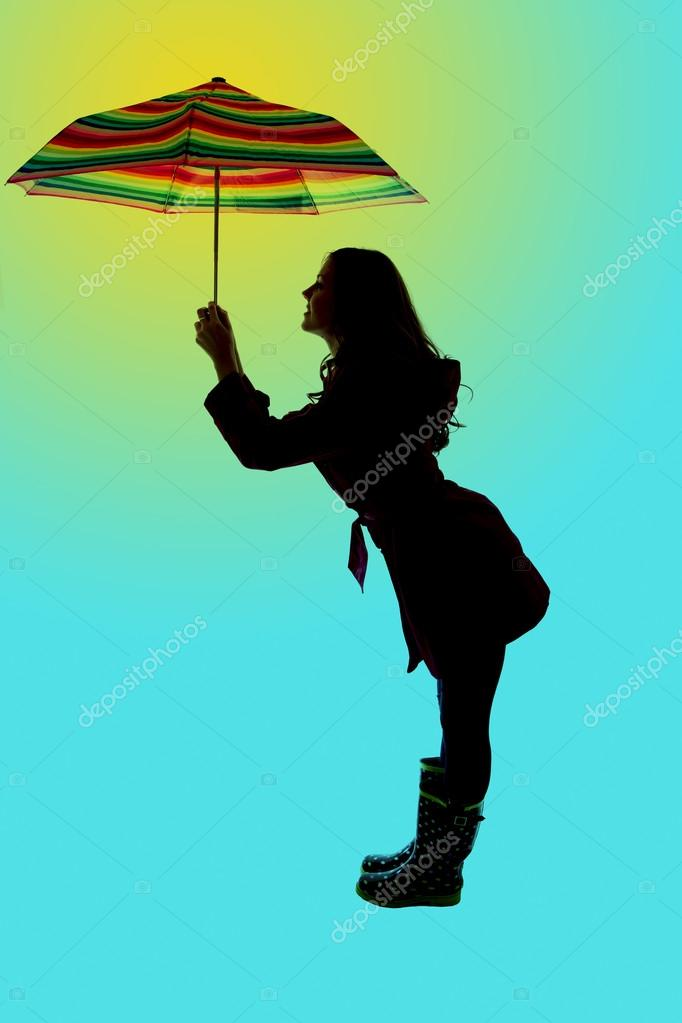 Cute Pose And Silhouette Of A Woman Holding An Umbrella Blue Bac