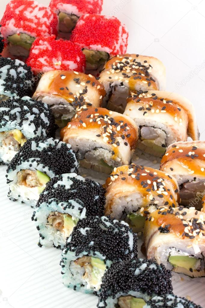 Sushi roll with red black tobiko and canada roll — Stock