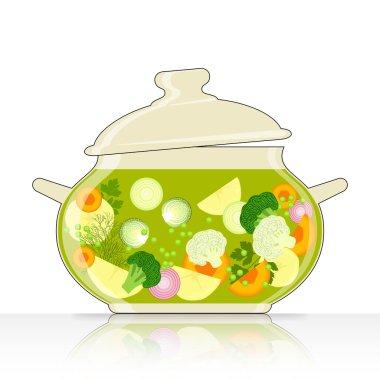 Saucepan with vegetable soup