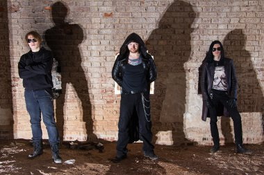 Photo of Metal band with brick background