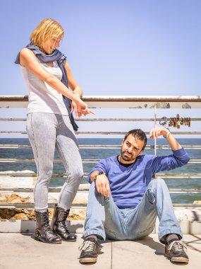 Girlfriend mocking handcuffed Boyfriend