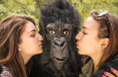 Two Girls kissing an astonished Gorilla