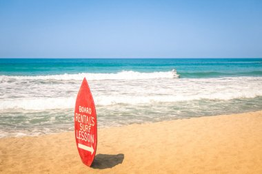 Surfboard at exclusive beach - Surfing school destinations worldwide