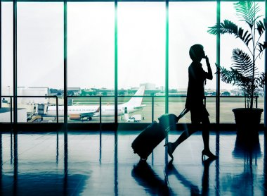 Business woman at Airport - Silhouette of a passenger stock vector