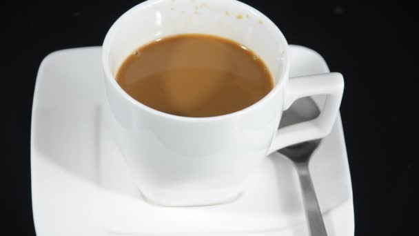 Pouring coffee into cup shooting