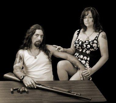 tough sexy man with tough sexy woman and a shotgun with shellson