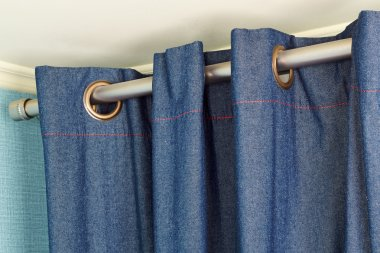 Denim  curtains  with ring-top rail
