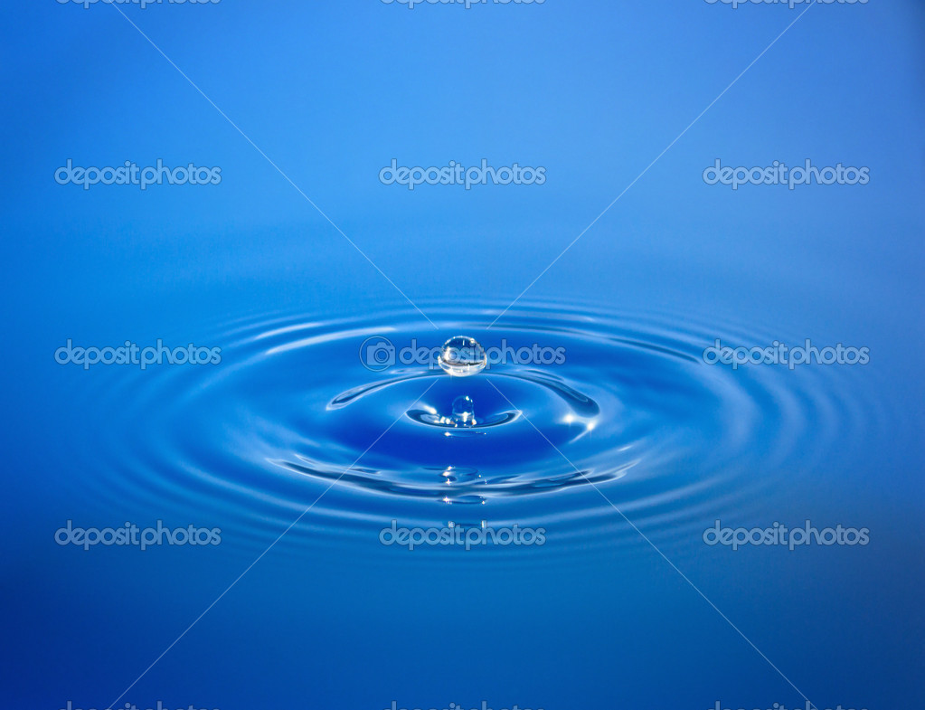 Drop isolated in blue water