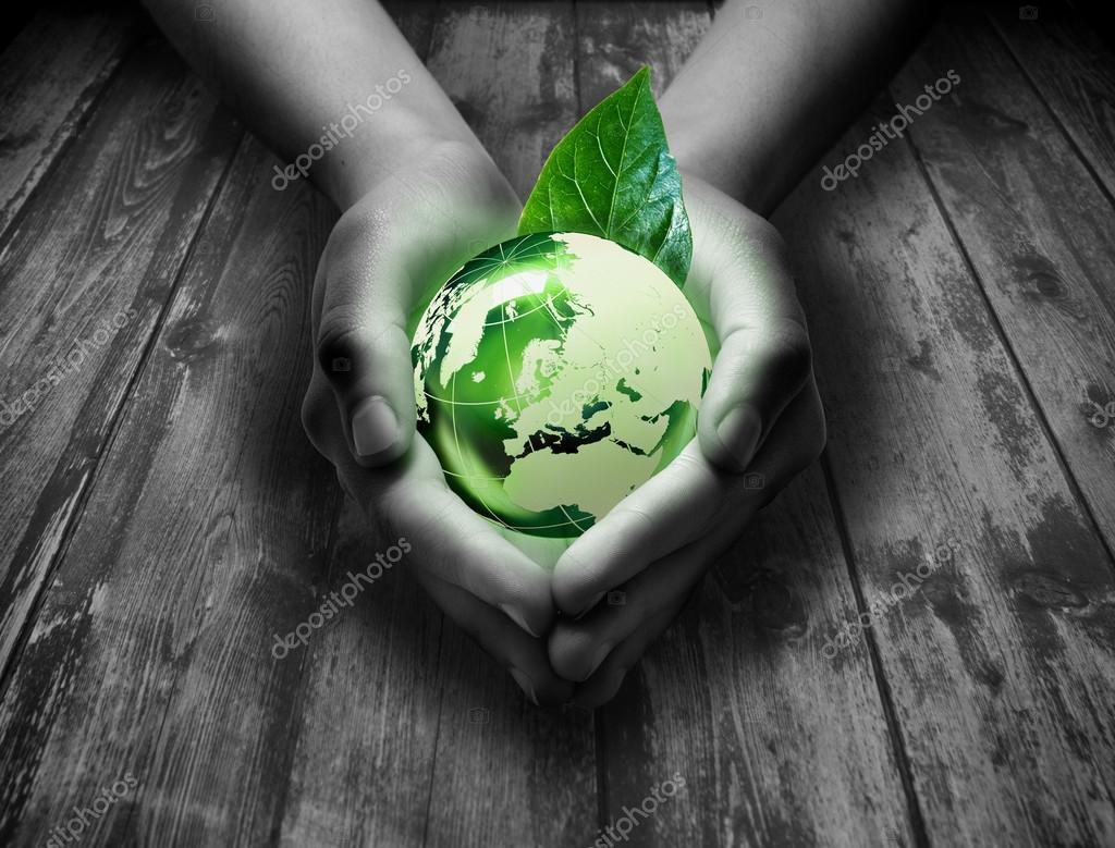 Protect green earth in hands