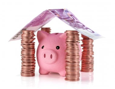 Put your savings safe - Piggybank in the home of Savings for real estate project