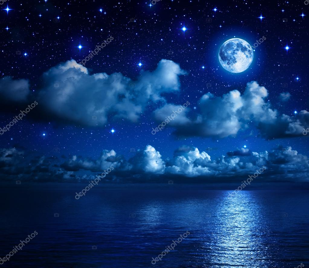 Фотообои Super moon in starry sky with clouds and sea