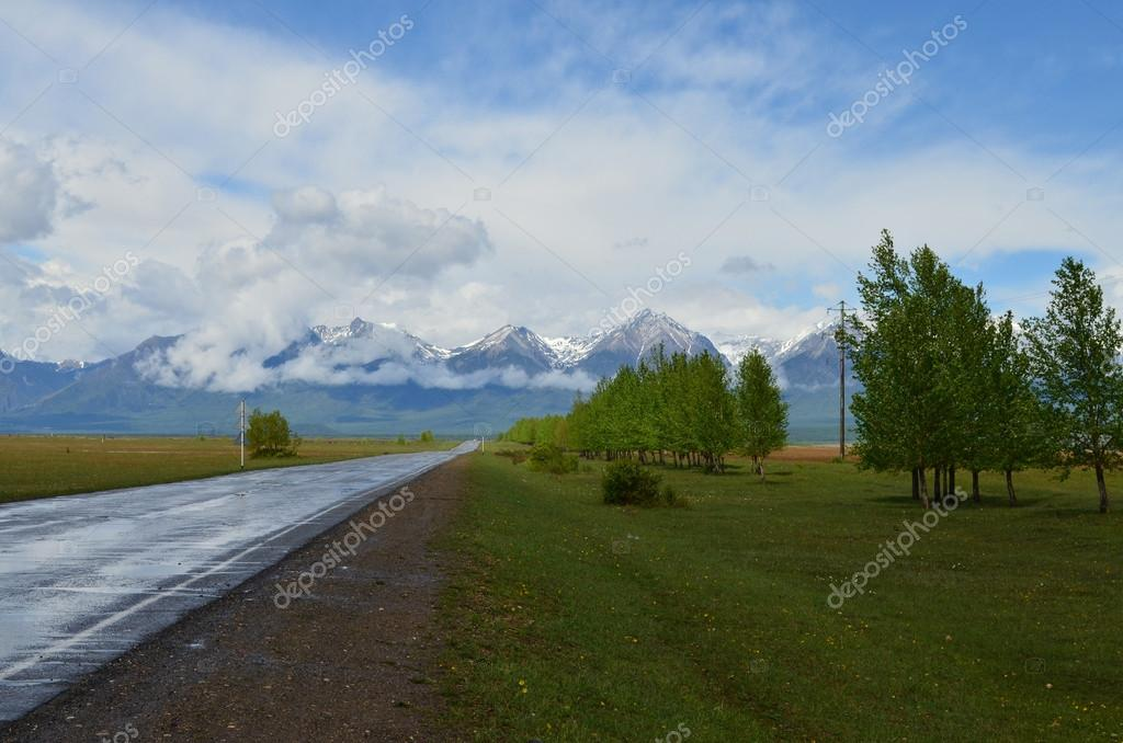 The road to mountains after a rain