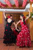 Photo Traditional flamenco dresses dance during the Feria de Abril on April Spain