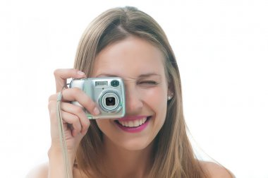 Beautiful woman in bikini making photo on the camera