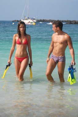 Couple with snorkelling ling gear