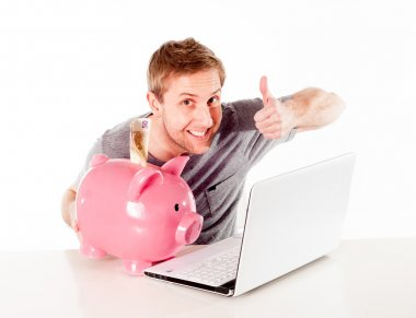 man with piggy bank and laptop thinking about online saving