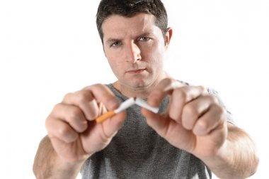 Attractive young man in Quit smoking resolution