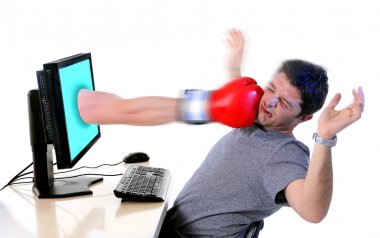 man with computer hit by boxing glove social media cyber mobbing