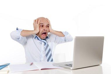 Bald latin businessman screaming at his latop