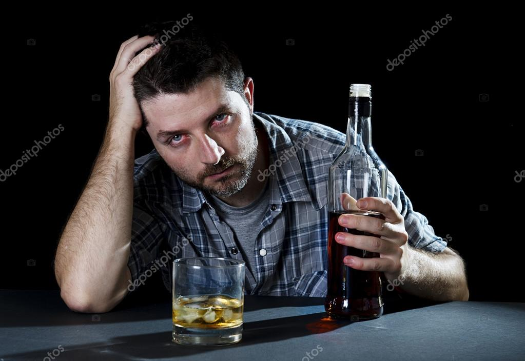 drunk alcoholic man with whiskey glass and bottle in alcohol addiction and alcoholism concept