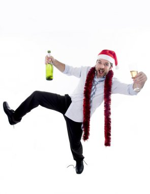 drunk businessman drinking champagne wearing a santa hat on white background