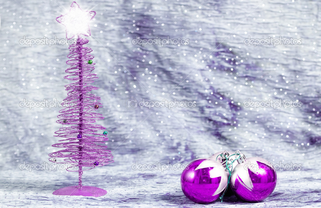 christmas tree with bright star with balls on silver background with space to write text photo by kiko_jimenez