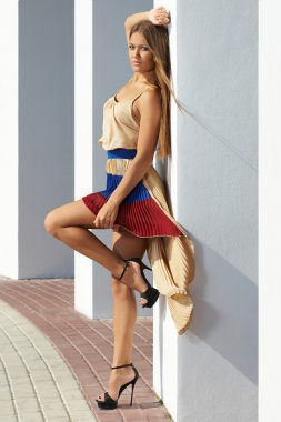 young woman posing glamorously fashion model