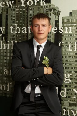 The groom in a suit