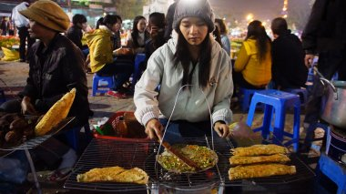 Vietnamese street food vendor at night outdoor market