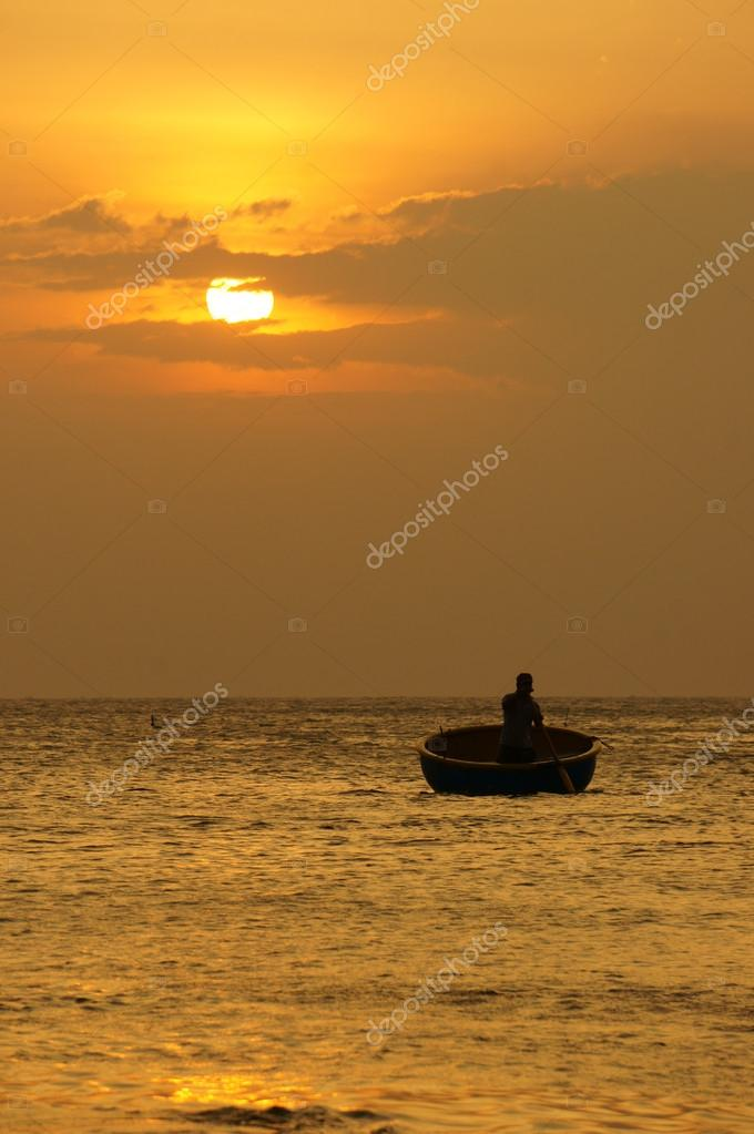 Beautiful landscape on ocean with silhouette fisherman, sun at s