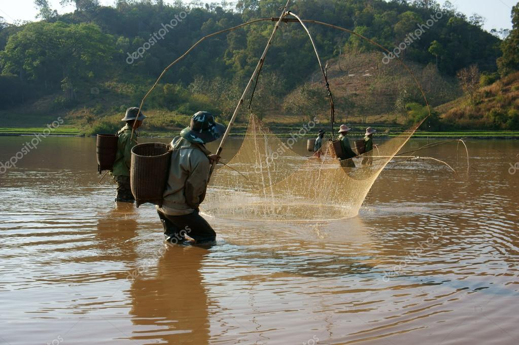 People catch fish by lift net on ditch stock editorial for People catching fish