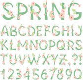 Photo Spring vector Alphabet with flowers and new green leaves
