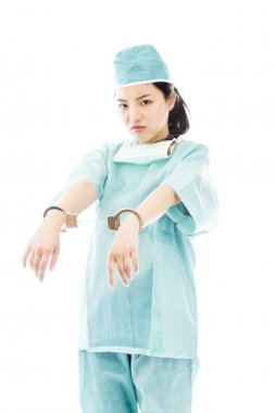 Surgeon with handcuffed hands