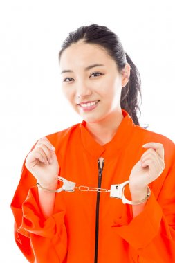 Handcuffed woman smiling