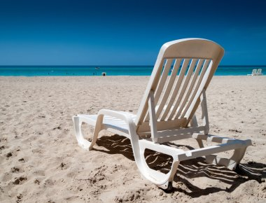 Reclining chair on the beach
