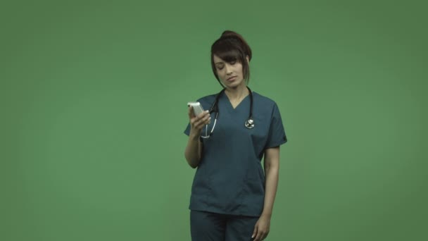 Indian female doctor with cell phone