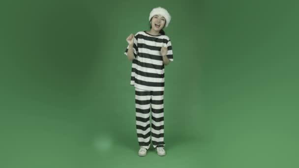 Asian  prisoner in santa claus hat