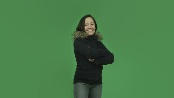 Girl in winter jacket with arms crossed