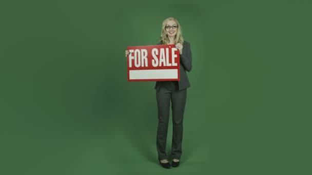 бізнес-леді проведення для продажу знак