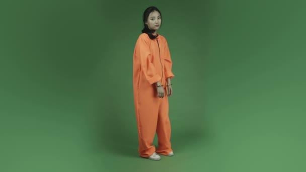 Woman prisoner depressed in handcuffs