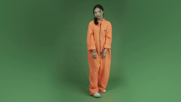 Woman prisoner carefree in handcuffs