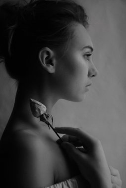 Portrait girl profile with flower rose. black and white