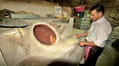 Bread baking in typical bakary in Middle East. Kurdistan, Iraq