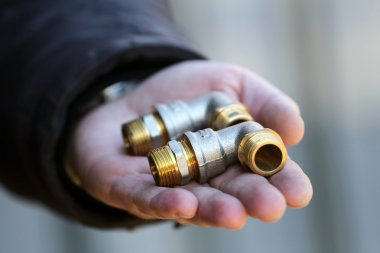 Connectors of plumbing pipes in the hand