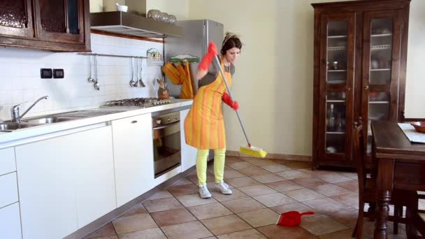 Happy housewife cleaning and dancing