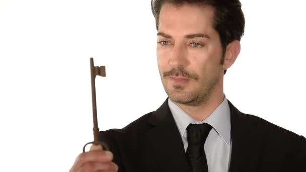 Businessman showing the key to success